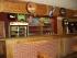 Barový pult, stoly, stoličky a drevené obloženie 109